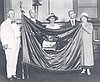 Flag being presented to Postmaster General, c. 1925, to hang in Washington, D.C.